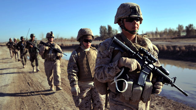 PHOTO: US Marine servicewomen from 2nd Battalion, 1st Marines Golf Company patrol in Basabad, Helmand Province, Afganistan, March 9, 2011.