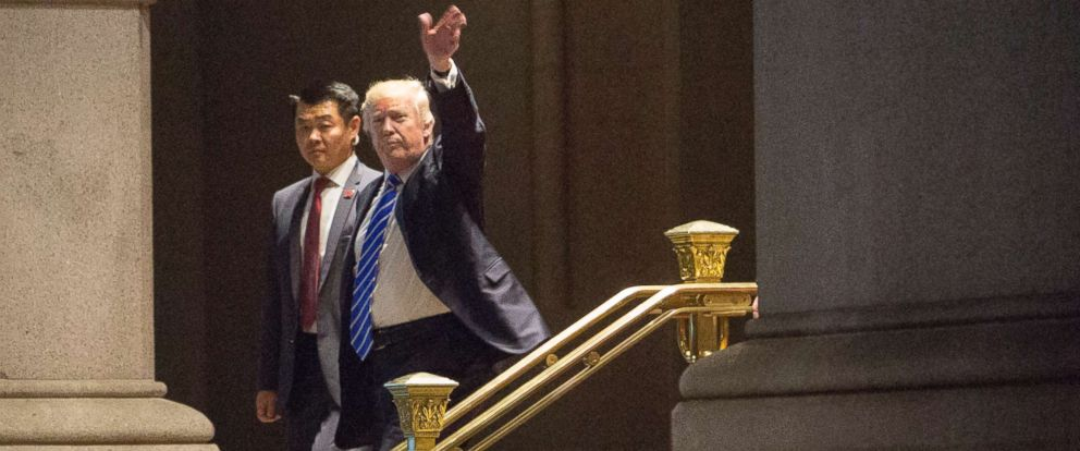 PHOTO: President Donald Trump waves to well wishers after dining at Trump International Hotel on July 29, 2017 in Washington, DC.