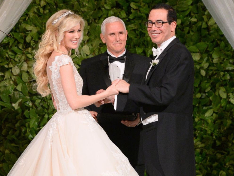 Vice President Mike Pence (C) officiates the wedding of Louise Linton (L) and Secretary of the Treasury Steven Mnuchin (R) on June 24, 2017 at Andrew Mellon Auditorium in Washington, DC.