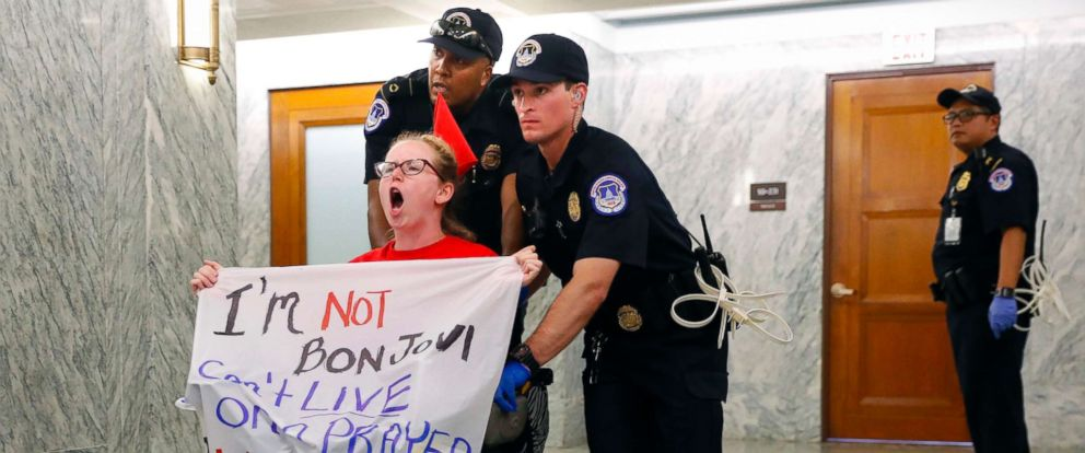 PHOTO: Capitol Police push a woman in a wheelchair as they detain her outside the hallway of the Senate Finance Committee hearing on the last-ditch GOP push to overhaul the nations health care system, on Capitol Hill in Washington, Sept. 25, 2017.