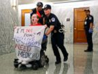 Protesters in wheelchairs removed by police after disrupting health bill hearing