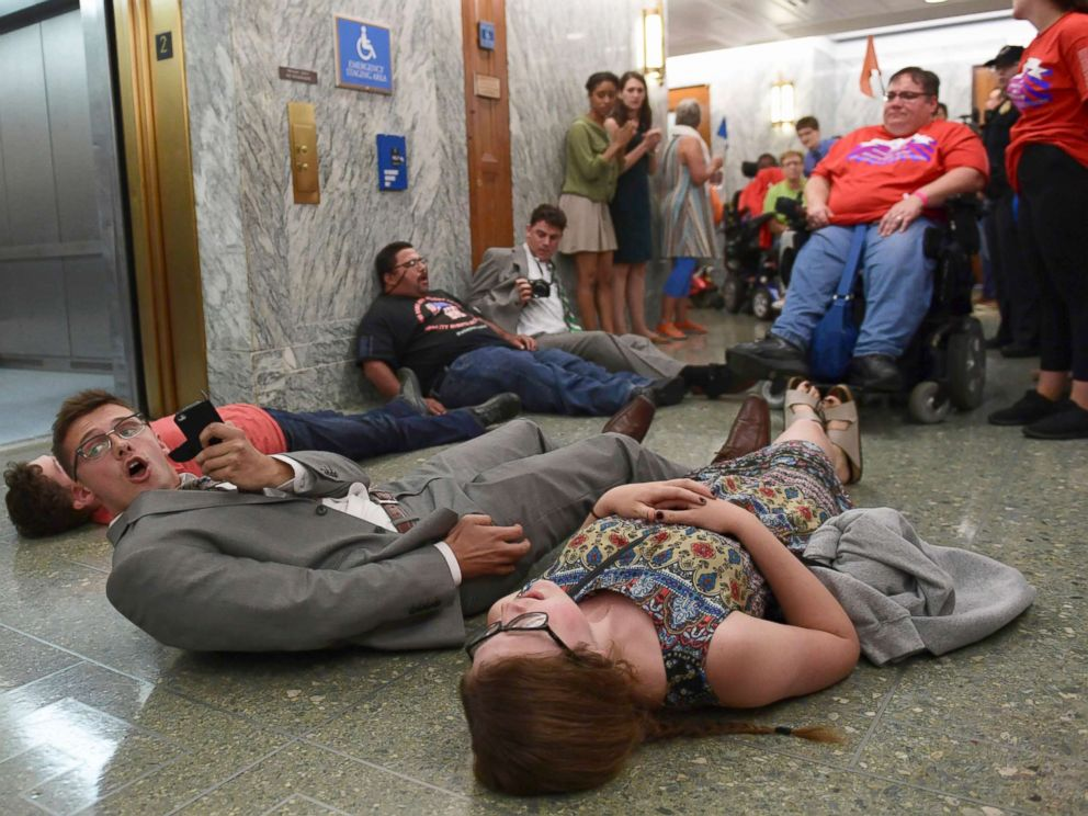 PHOTO: Protesters lay on the floor as they wait to be arrested by Capitol Police as they attempt to maintain order in the hallways on Capitol Hill in Washington, Sept. 25, 2017.