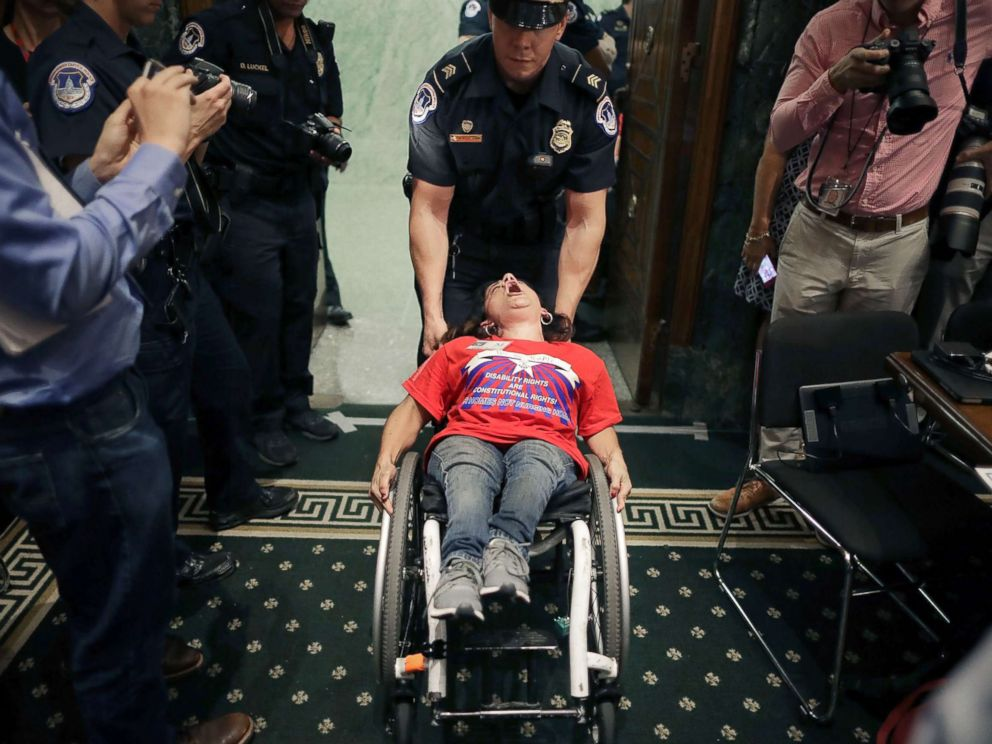 PHOTO: Capitol Police remove a protester in a wheel chair from a Senate Finance Committee hearing about the proposed Graham-Cassidy healthcare bill in the Dirksen Senate Office Building on Capitol Hill, Sept. 25, 2017, in Washington.