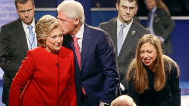 'PHOTO: Former President Bill Clinton kisses Democratic presidential nominee Hillary Clinton as she and their daughter Chelsea Clinton greet supports during the presidential debate1_b@b_1Hofstra University in Hempstead, N.Y., Sept. 26, 2016.' from the web at 'http://a.abcnews.com/images/Politics/hillary-bill-chelsea-clinton-file-ap-jef-180105_16x9t_384.jpg'