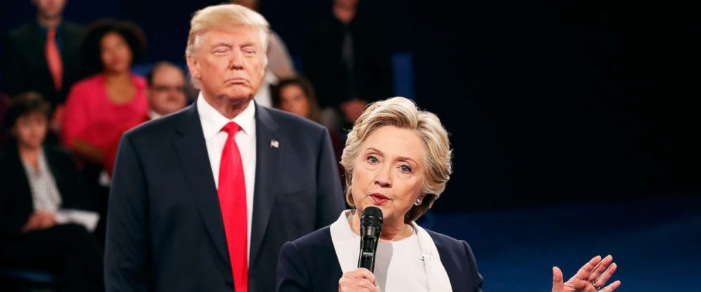 PHOTO: Former Secretary of State Hillary Clinton, right, speaks as Republican presidential nominee Donald Trump looks on during the town hall debate at Washington University, Oct. 9, 2016, in St Louis, Missouri.
