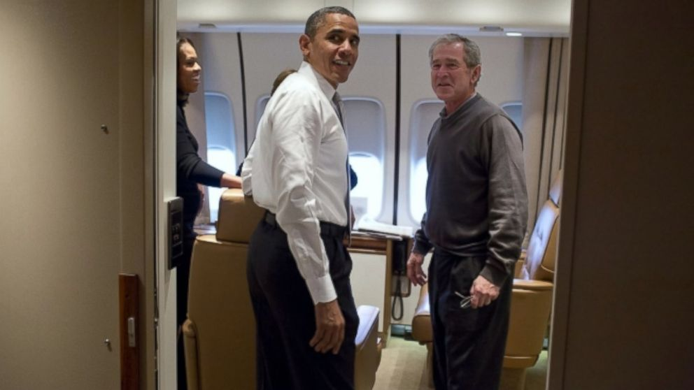 President Barack Obama jokes with former President George W. Bush sh