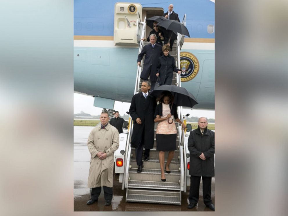 PHOTO: President and Mrs. Obama, former President and Mrs. Bush, and former Secretary of State Hillary Clinton arrive in South Africa, Dec. 10, 2013.