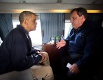 President Barack Obama and New Jersey Gov. Chris Christie talk as they fly over the coast of New Jersey on Marine One, Oct. 31, 2012.
