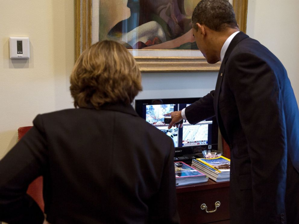 PHOTO: President Barack Obama watches television coverage of the Boston Marathon bombings with Lisa Monaco in the Outer Oval Office, April 15, 2013.