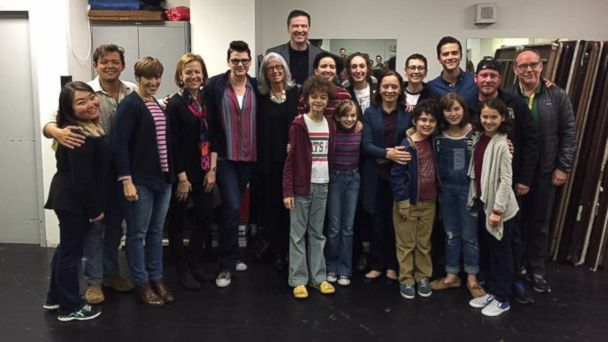 PHOTO: Former FBI director James Comey (center) and his wife Patrice (wearing eyeglasses) with the cast of the musical