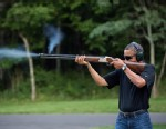 PHOTO: President Barack Obama shoots clay targets on the range at Camp David, Md., Saturday, Aug. 4, 2012.