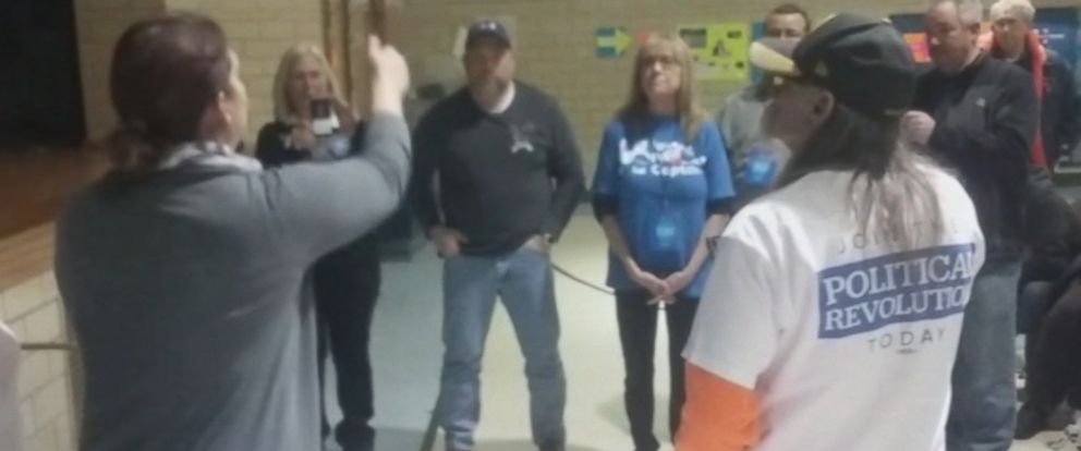PHOTO: Some of the county delegates in certain Iowa precincts were so close that they used a coin toss to decide.