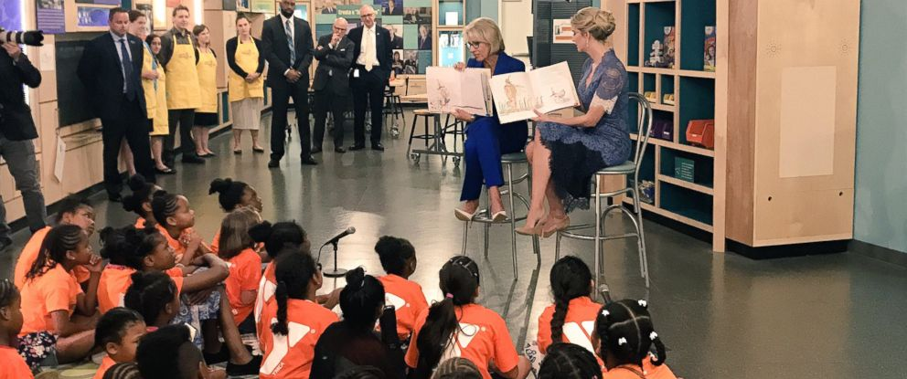 PHOTO: Education Secretary Betsy DeVos and Adviser to the President Ivanka Trump read to girls at the Smithsonian's National Museum of American History in Washington, D.C., on July 25, 2017.
