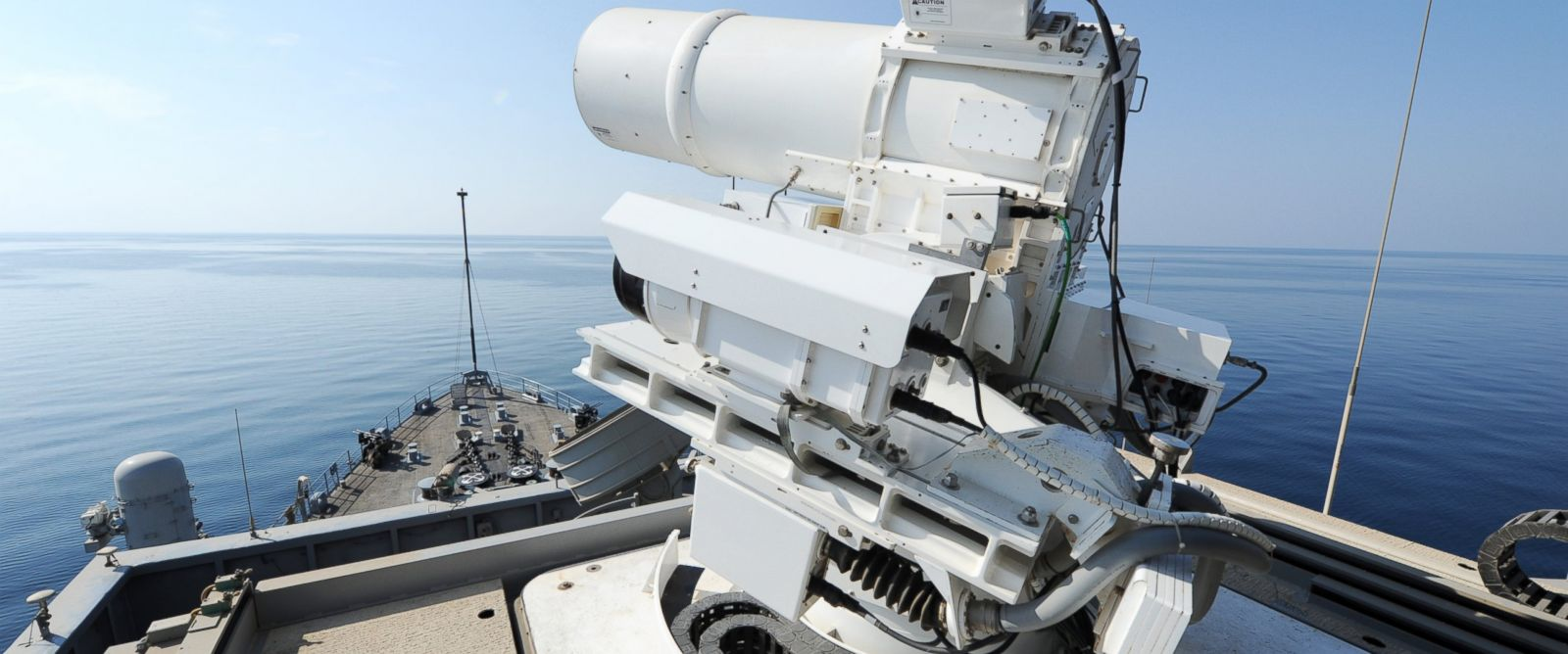 PHOTO: The Afloat Forward Staging Base (Interim) USS Ponce (ASB(I) 15) conducts an operational demonstration of the Office of Naval Research (ONR)-sponsored Laser Weapon System (LaWS) while deployed to the Arabian Gulf.
