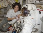 PHOTO: NASA astronaut Sunita Williams, Expedition 32 flight engineer, poses for a photo with her Extravehicular Mobility Unit (EMU) spacesuit in the Quest airlock of the International Space Station on Aug. 23, 2012.