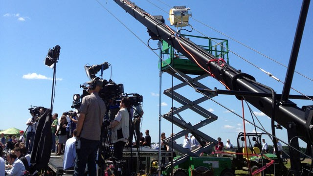 PHOTO: Crew filming Mitt Romney's bus tour kick-off speech in Stratham, N.H June 15, 2012.