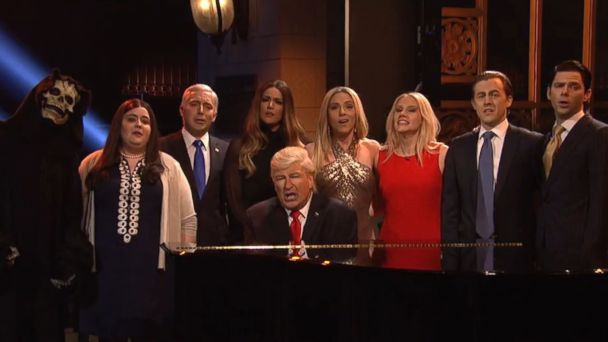 PHOTO: Alec Baldwin (sitting at the piano) as Donald Trump, flanked by various cast members and guest stars impersonating Team Trump on