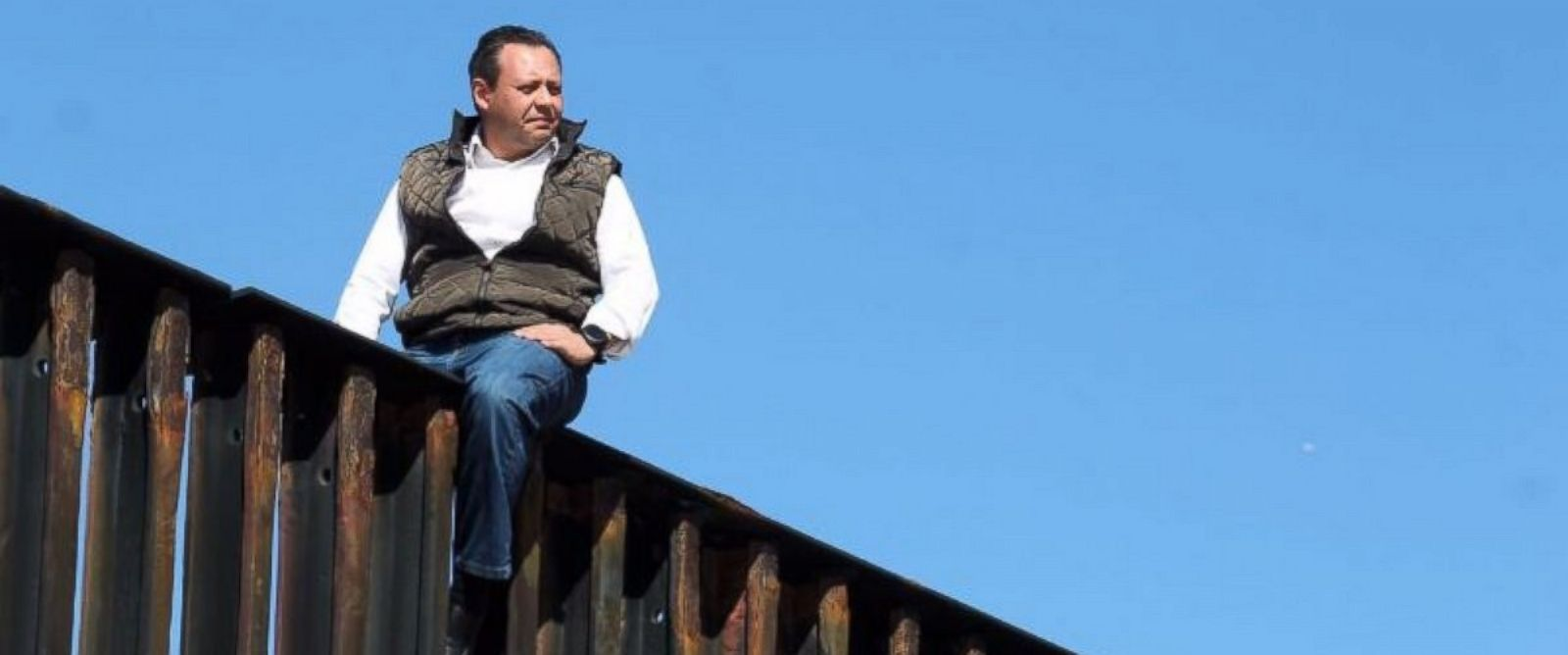 PHOTO: Mexican congressman Braulio Guerra sits atop the U.S.-Mexico border wall that divides Tijuana, Mexico, from California on March 1, 2017.