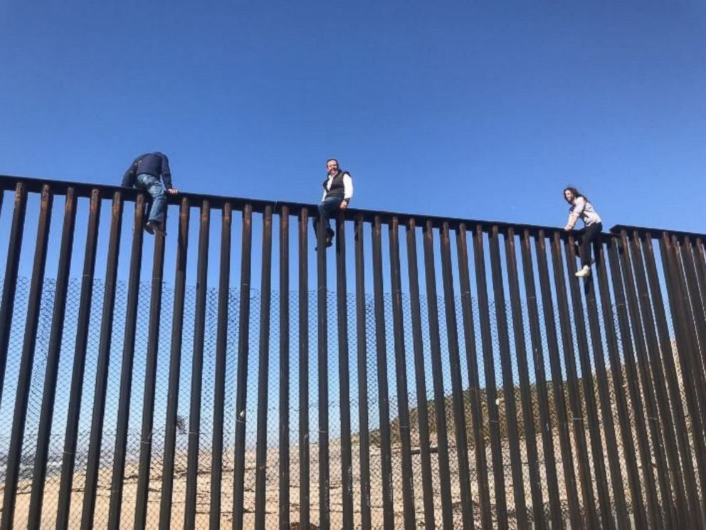 PHOTO: Mexican congressman Braulio Guerra sits atop the U.S.-Mexico border wall that divides Tijuana, Mexico, from California on March 1, 2017