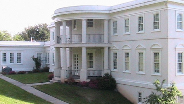 PHOTO:&nbsp;This house uses some of the design features of the White House, which would have to be scaled down to the size of a residence.
