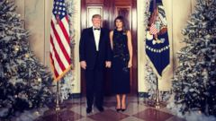 'PHOTO: President Donald Trump and first lady Melania Trump in their official 2017 Christmas portrait, taken1_b@b_1the White House on December 5, 2017, and released on December 15, 2017.' from the web at 'http://a.abcnews.com/images/Politics/ht_xmas_dc_121517_16x9t_240.jpg'