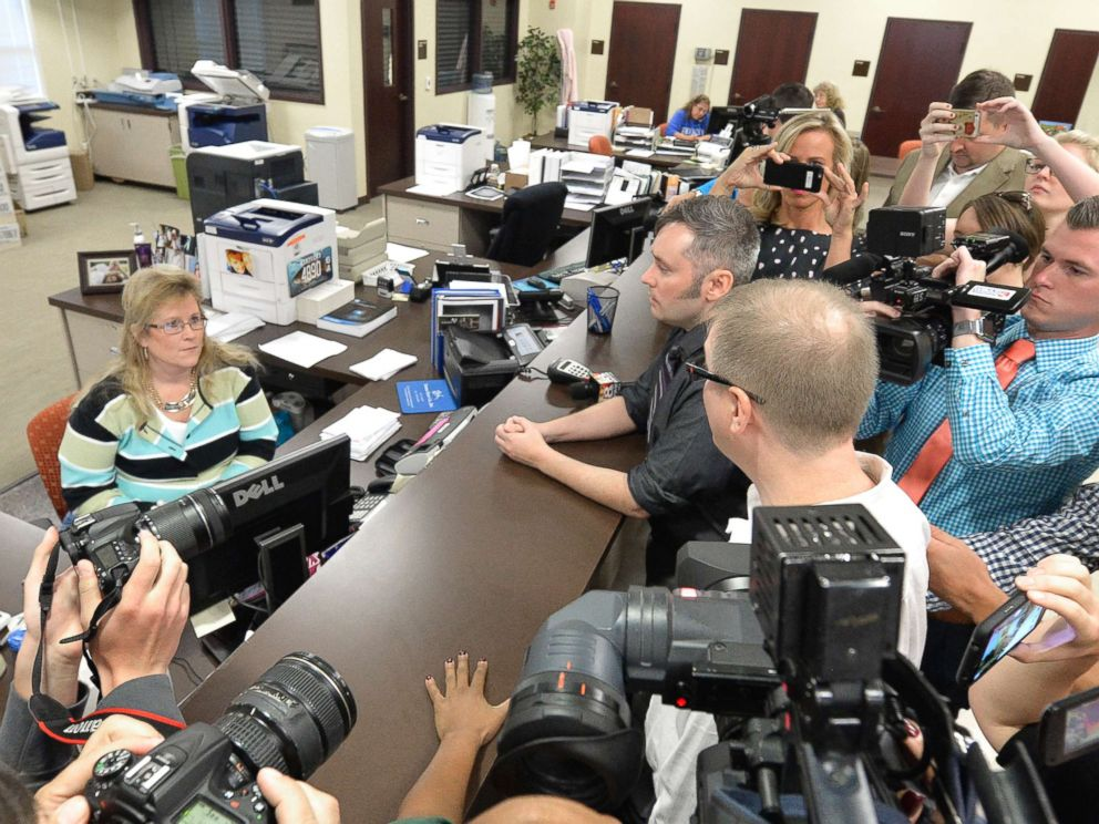 PHOTO: David Moore, center, and his partner David Ermold attempt to apply for a marriage license at the Rowan County Courthouse in Morehead, Ky., Sept. 1, 2015.