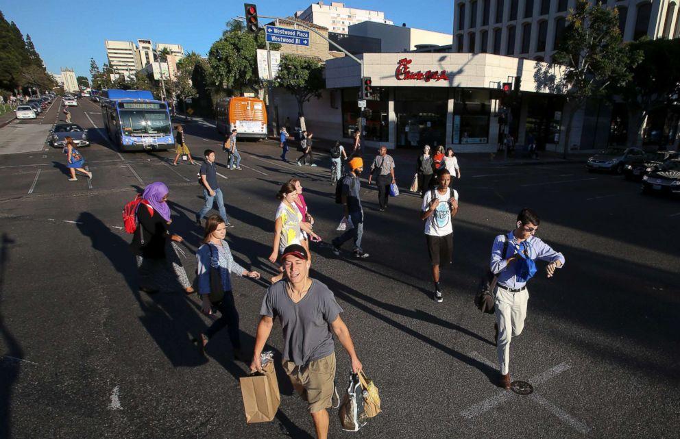 PHOTO: Pedestrians cross a street in Los Angeles, Calif., Sept. 22, 2014.