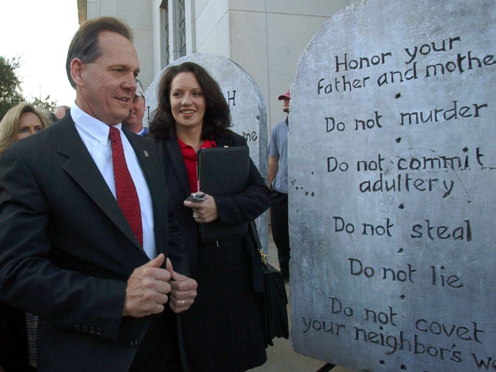 PHOTO:Roy Moore looking at a Ten Commandments display used in a rally as he arrives at the Judicial Building in Montgomery, Ala., Nov. 12, 2003.