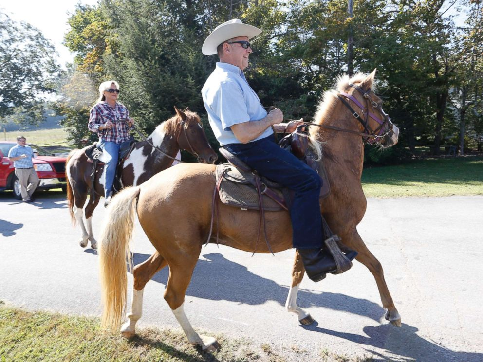 PHOTO: Alabama Republican U.S. Senate candidate Roy Moore on Sassy and wife Kayla on Sundance ride their horses to the Gallant Fire Hall to vote in the GOP runoff election Sept. 26, 2017 in Gallant, Ala.
