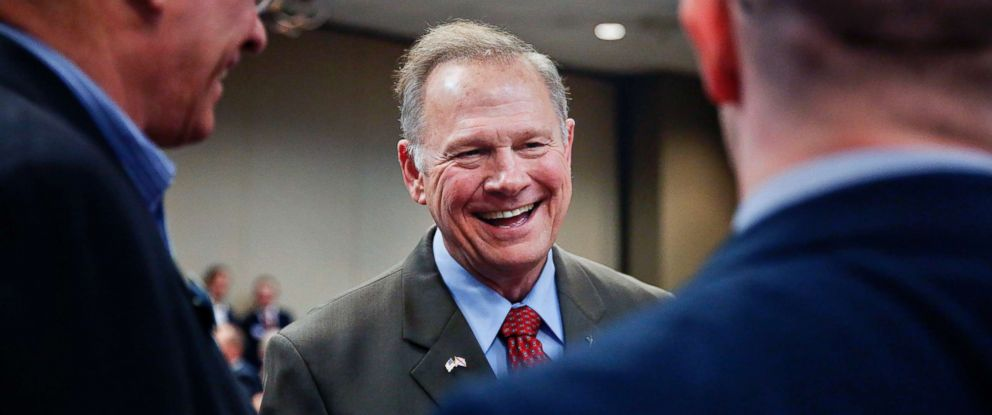 PHOTO: Former Alabama Chief Justice and U.S. Senate candidate Roy Moore, talks to constituents before a Republican Senate candidate forum, Aug. 4, 2017, in Pelham, Ala.
