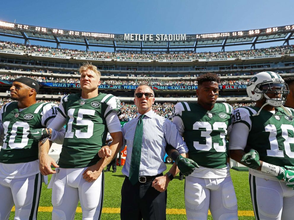PHOTO: Jermaine Kearse #10, Josh McCown #15, Jamal Adams #33, ArDarius Stewart #18 and Christopher Johnson CEO of the New York Jets stand in unison with his team during the National Anthem prior to an NFL game, Sept. 24, 2017 in East Rutherford, N.J.