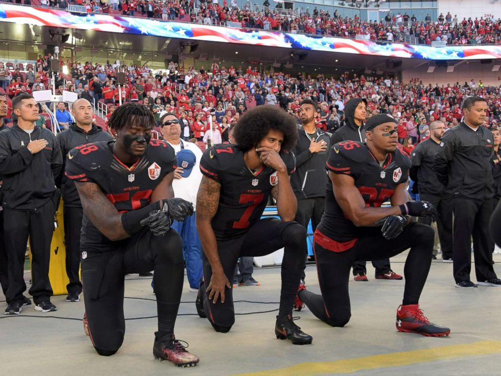 PHOTO: San Francisco 49ers outside linebacker Eli Harold (58), quarterback Colin Kaepernick (7) and free safety Eric Reid (35) kneel in protest during the playing of the national anthem in Santa Clara, Calif., Oct 6, 2016.
