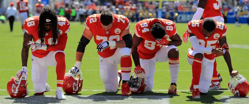 PHOTO: Terrance Smith, Eric Fisher, Demetrius Harris, and Cameron Erving #75 of the Kansas City Chiefs is seen taking a knee before the game against the Los Angeles Chargers at the StubHub Center on Sept. 24, 2017 in Carson, Calif.