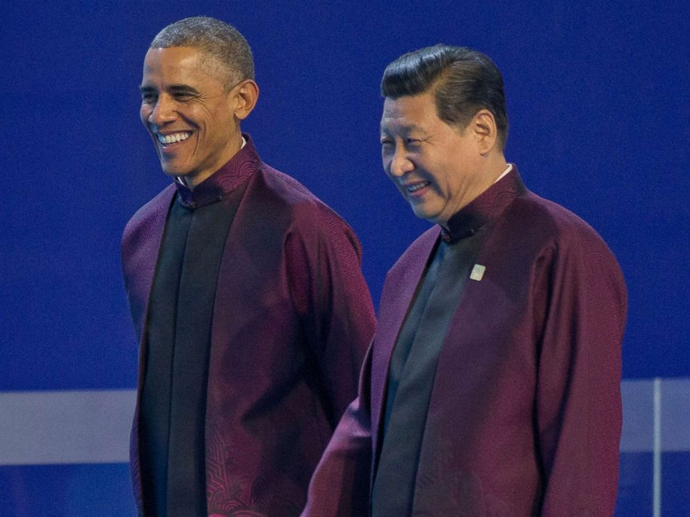 PHOTO: President Barack Obama, left, and Chinese President Xi Jinping walk during the Asia-Pacific Economic Cooperation (APEC) Summit family photo, Nov. 10, 2014 in Beijing.