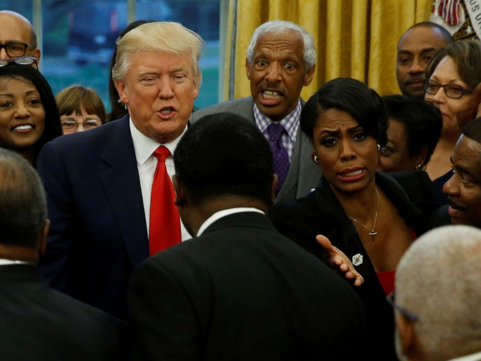 'PHOTO: White House aide Omarosa Manigault (center R) and President Donald Trump (center L) with the leaders of dozens of historically black colleges and universities (HBCU) in the Oval Office1_b@b_1the White House in Washington, D.C., Feb. 27, 2017.' from the web at 'http://a.abcnews.com/images/Politics/omarosa-trump-rt-jt-171216_4x3_992.jpg'