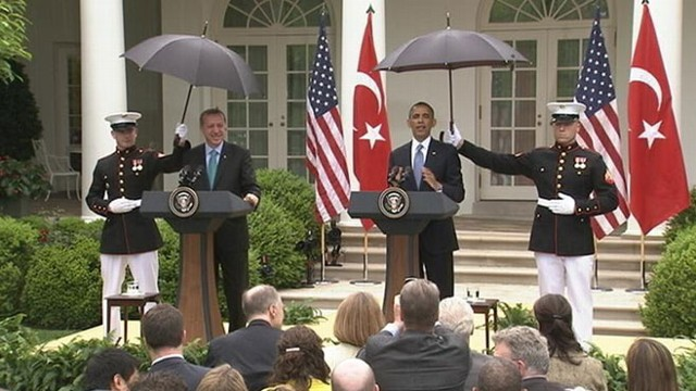 VIDEO: The president enlists the help of Marines to hold umbrellas during Rose Garden press conference.