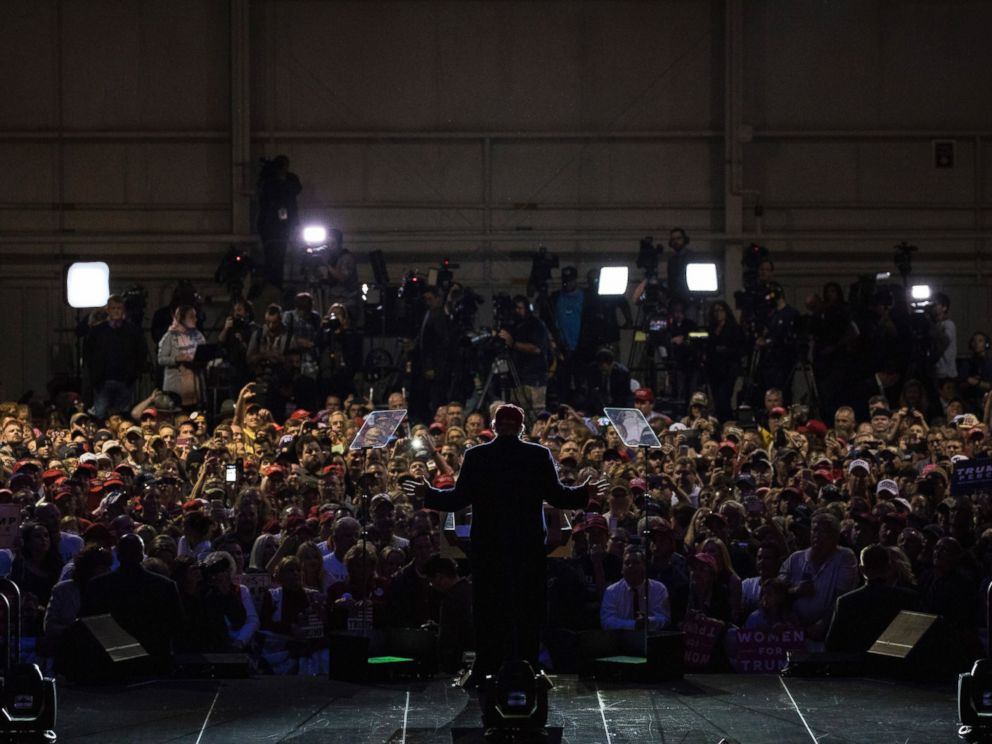 PHOTO: Donald Trump speaks during a campaign event at the Pittsburgh International Airport, Nov. 6, 2016. Members of the media are positioned behind the crowd.