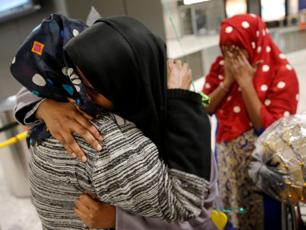 PHOTO: Roodo Abdishakur (2nd L), a Somali national who was delayed entry to the U.S. because of the recent travel ban, is greeted by her mother Zahra Warsma (L) at Washington Dulles International Airport in Chantilly, Va., Feb. 6, 2017.