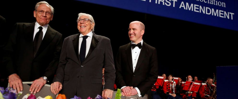 PHOTO: Former Washington Post reporters Bob Woodward (L-R) and Carl Bernstein stand with White House Correspondents Association President Jeff Mason of Reuters at the head table before the associations dinner in Washington, D.C., April 29, 2017.