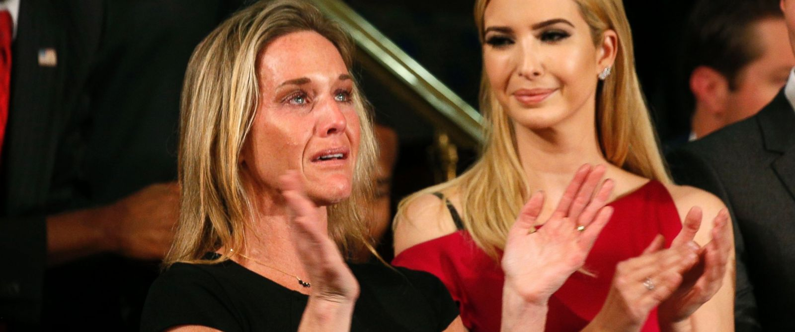 """PHOTO: Carryn Owens, widow of Senior Chief Petty Officer William """"Ryan"""" Owens, applauds after being mentioned by President Trump during his address to a joint session of the U.S. Congress on Feb. 28, 2017 in Washington, DC."""