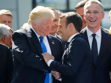 PHOTO: President Donald Trump jokes with French President Emmanuel Macron about their prior hand shake which had drawn attention for its intensity, during an event with other NATO leaders in Brussels, May 25, 2017.