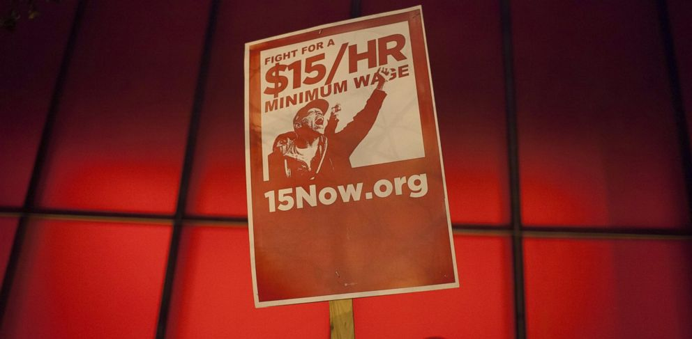 PHOTO: A protest sign is held up during a rally to raise the hourly minimum wage to $15 for fast-food workers at City Hall in Seattle, Dec. 5, 2013.