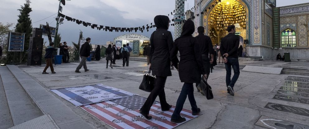 PHOTO: People step on a US flag and an Israeli flag at a shrine on Ashura in the north of Tehran Oct. 24, 2015.