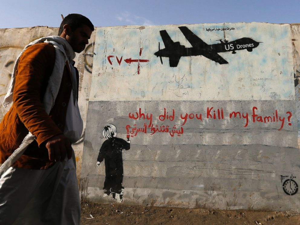 PHOTO: A man walks past a graffiti denouncing strikes by U.S. drones in Yemen on a wall in Sanaa, Nov. 13, 2014.