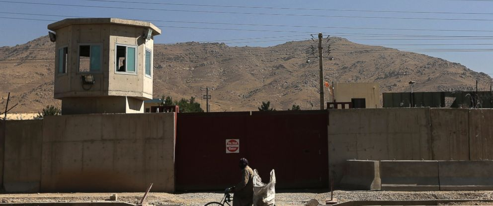 PHOTO: A NATO helicopter flies overhead at the site of an incident after a blast, outside the counter-narcotics office near the Kabul International Airport, July 22, 2014.