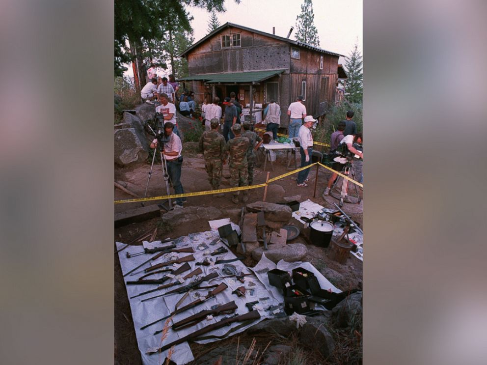 PHOTO: Federal agents and members of the media tour the outside of Randy Weavers home, Sept. 1, 1992 near Naples, Idaho.