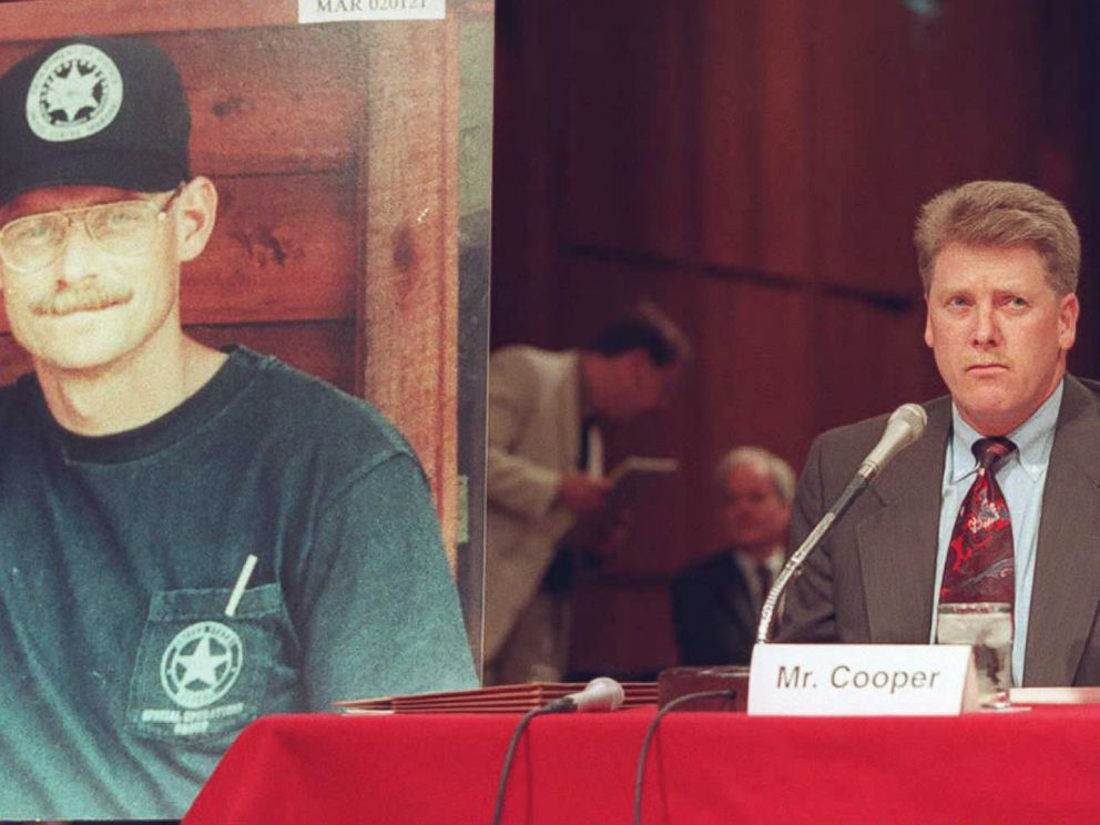 PHOTO: Deputy U.S. Marshal Larry Cooper, right, testifies Sept. 15, 1995, before the Senate subcommittee investigating the FBI siege at Ruby Ridge, Idaho, with a photo of Deputy U.S. Marshal William Degan, who was killed in the shootout, beside him.