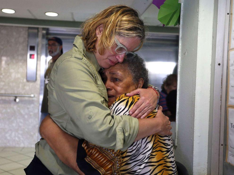 PHOTO: San Juans Mayor Carmen Yulin Cruz, left, hugs a woman during her visit to an elderly home in San Juan, Puerto Rico, Sept. 22, 2017.