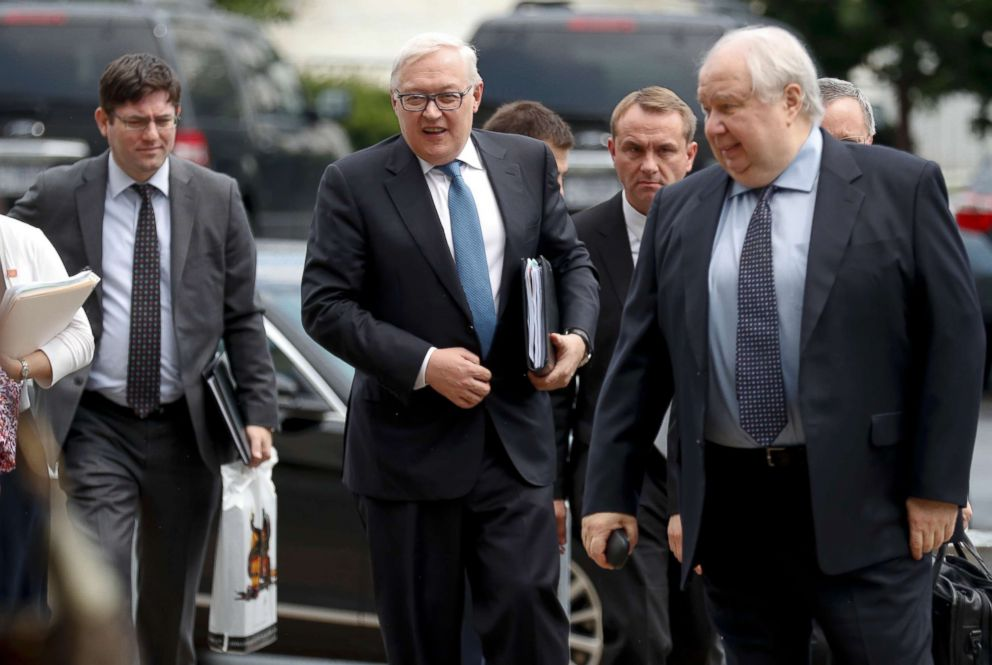 PHOTO: Russian Deputy Foreign Minister Sergei Ryabkov, second from left, and Russian Ambassador to the U.S. Sergey Kislyak, right, arrive at the State Department in Washington, July 17, 2017.