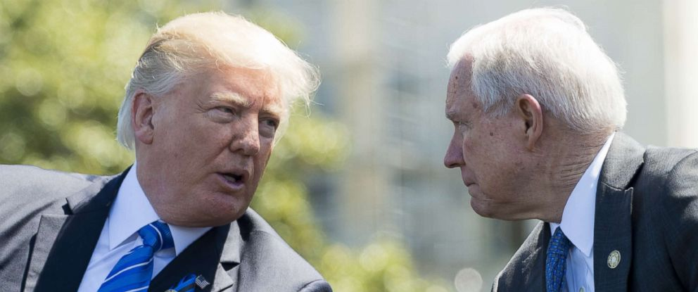 PHOTO: President Donald Trump speaks with Attorney General Jeff Sessions during the 36th Annual National Peace Officers Memorial Service at the Capitol, May 15, 2017.